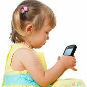 Little Girl Playing With Smartphone.