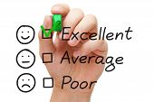 stock photo of measurements  - Hand putting check mark with green marker on excellent customer service evaluation form - JPG