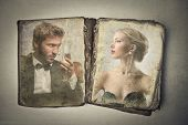 antique book illustrated with a pair of young lovers