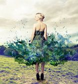 stock photo of undressing  - blonde woman with elegant green dress - JPG