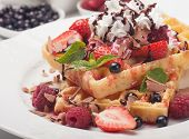 Waffle cake with fresh fruit and whipped cream