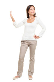 picture of snob  - Full length of young woman with hand on hip making stop gesture isolated over white background - JPG