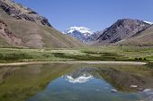 stock photo of aconcagua  - Aconcagua mountain reflected at a lake Argentina - JPG