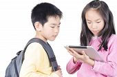 Smart children using touch pad computer on white background