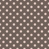 Seamless vector pattern with beige polka dots on a dark brown background.