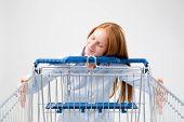 Woman Hugging A Shopping Cart