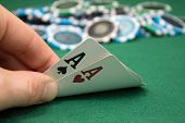 foto of poker hand  - A poker player is showing his pocket hand - JPG