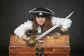 image of pirate girl  - Woman the pirate with a sabre and chest with treasures - JPG