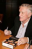 Hugh Hefner   at an in store appearance signing copies of his books 'Mr. Playboy' and 'Playboy The C