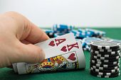 stock photo of poker hand  - A poker gambler showing his pocket hands - JPG