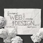Hand Drawn Web Design Diagram On Crumpled Paper Background As Concept