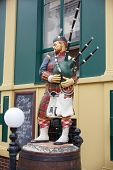 Statue Of A Scottish Bagpipe Player