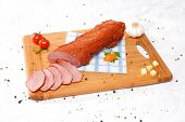 Wooden Chopping Board With Sliced Ham And Spices