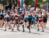 Dance Troupe Performs In Parade