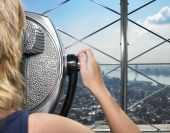 Woman Looking Through Viewer At City