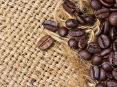 Coffee Beans On Vintage Linen Background