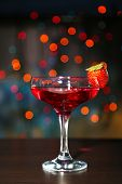 Tasty strawberry cocktail on bright background
