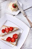 Fresh toast with  homemade butter and fresh strawberry on plate on wooden background