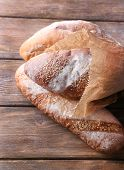 Fresh bread on wooden background