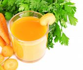Glass of carrot juice with fresh carrots and parsley isolated on white