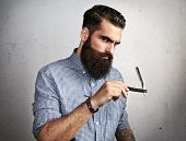 Brutal man with vintage straight razor
