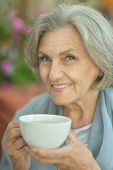 elderly woman drinking tea