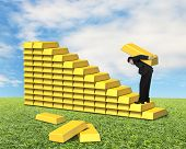 Businessman Carrying Bullion Climbing On Gold Stairs