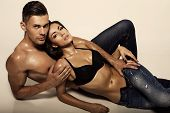 picture of hot couple  - fashion photo of sexy impassioned couple wearing jeans - JPG