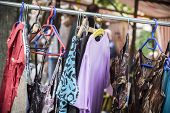 foto of thrift store  - clothes on a rack on a flea market - JPG
