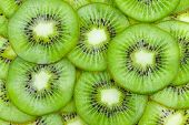 stock photo of tropical food  - Background with fruit kiwi slices as texture - JPG