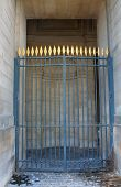 Locked Blue Gate With Gold Spear Tips