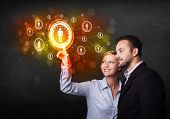 Business couple touching future technology social network button