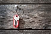 Keys with a tag on wooden background