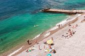 Vacationers Swim And Sunbathe On The Black Sea In Yalta