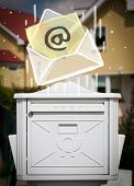White envelope with email sign dropping into mailbox
