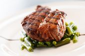 grilled steak with beans