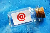 E-mail address at symbol message in a bottle concept for contact us, assistance and business support