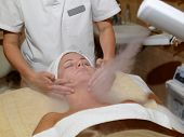 Beautiful Woman Receiving Facial Treatment At A Spa