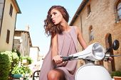 foto of scooter  - Italian woman on a scooter on the streets of the Tuscan town - JPG