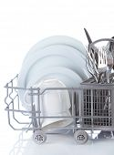 Clean dishes drying on metal dish rack, isolated on white
