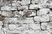 Abstract background of a painted white dry stone wall.