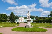 Marble Statue And Palace. Summer Day.