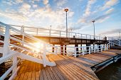 Beautiful retro pier at sunset over Baltic sea. Gdansk Brzezno, Poland