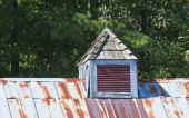 Rusty Roof Cupola And Weather Vane poster