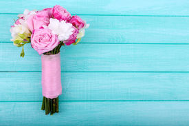 stock photo of rosa  - Beautiful wedding bouquet on wooden background - JPG