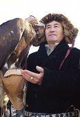 Nura, Kazakhstan - February 23: Eagle On Praying Man's Hand In Nura Near Almaty On February 23, 2013