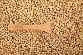 stock photo of soybeans  - Soybeans with wooden spoon with soybeans as background - JPG