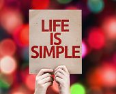 Life Is Simple card with colorful background with defocused lights
