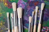 Close Up Of Wooden Paint Brushes On Oil Paints