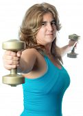 Hispanic woman exercising with weights raising a pair of dumbbells to shoulder height isolated on white